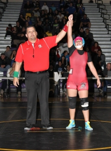 Shown above wearing a pink hair cap and red singlet is Jessica Rodriguez of Lincoln High School